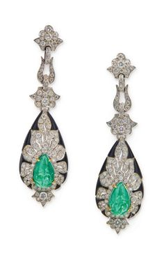 EMERALD, DIAMOND AND ONYX PENDANT-EARRINGS:  Suspending pear-shaped pendants centering carved emeralds, set with round diamonds, accented by onyx segments, mounted in platinum.  Via Sotheby's.