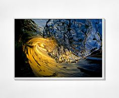 """Be right in the moment with this incredible wave shot by world-renowned water photographer Clark Little. Little captured this wave, exclusivley for Whisper, just as it arced and framed the rising sun on a calm, windless morning on the North Shore of Oahu, Hawaii. """"Hana Hou,"""" comes from the Hawaiian language. It's an appreciative response, the equivalent of """"bravo."""""""