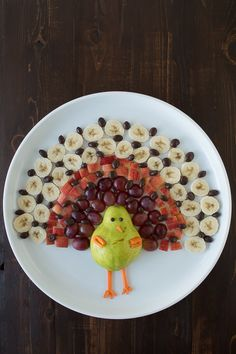ed26f770 Create a healthy fruit platter for Thanksgiving in the shape of a turkey  using a pear, grapes, apples, bananas, and chocolate covered raisins!