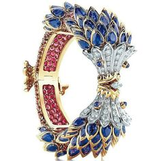Tiffany & Co. Schlumburger Fish bracelet in 18k gold and platinum, set with blue sapphires, red spinels and white diamonds.
