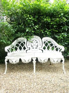 Beautiful and ornate wrought iron garden bench.