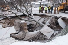 A water main break caused this massive sinkhole to form in Grand Rapids, Michigan in January 2013.  Read more at: http://www.greenerideal.com/science/0311-the-day-the-earth-swallowed-a-man-stories-about-sinkholes/ | Greener Ideal
