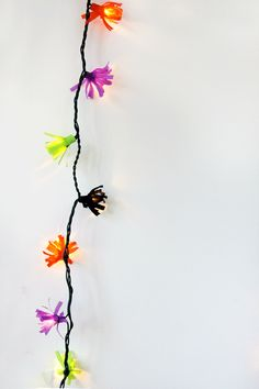 """""""DIY fringe string lights! Oh, if only I could tell you how long I've been wanting to do this. It's so simple and, yes, removable so you can switch it out for any holiday, birthday or other bash you may be throwing. Nothing like pulling those Christmas lights out of storage before December rolls around, right? First up, Halloween!"""""""
