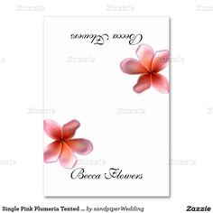 Folded white place cards with pink plumeria flowers.  Add names to both sides and stand at place setting for tropical / summer / beach / #Hawaiian themed wedding or party.
