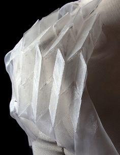 Constructed textiles for fashion combining clear pleated plastic with fabric for structure & contrast // Mylinh Nguyen