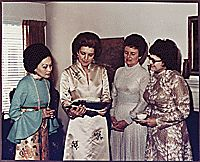 Photograph of Betty Ford and Three Unidentified Women Looking at Photographs, 197