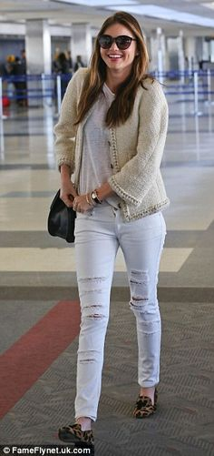 Setting a shining example: Miranda looked comfortable in ripped white jeans, a matching top and cream-coloured jacket, which she teamed with...