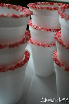 Cocoa cups edged in white chocolate and peppermint flavored sprinkles.