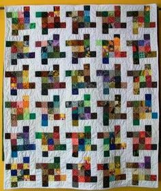 Sutured for a Living: Flying Squares Baby Quilt  Love the colors
