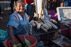 PhotoNotes - FotoNotas  A street vendor selling roasted corncob Una vendedora ambulante vendiendo elote asado  For image licensing visit my image librarywww.juanca...
