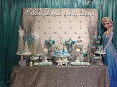 Lovely backdrop and dessert table at a Frozen birthday party!  See more party planning ideas at CatchMyParty.com!