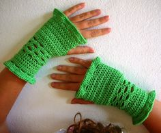 Wrist warmers with a bit of ruffles, crochet.    @Courtney Cartrette I think you should make these and wear them for derby