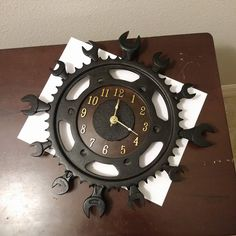 Wall clock made from used motorcycle parts and vintage wrenches. Also used warn out grinding disc to complete clock face. SOLD