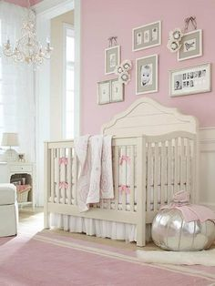 It's a Girl! Paint the nursery walls with Sherwin-Williams paint color Reverie Pink (SW 6856).