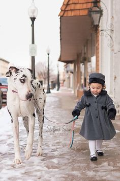 My wife is a photographer and she took this priceless photo.  It is my favorite photo to date, I thought this site would like it.  It is a picture of our beautiful daughter Savannah and our beautiful Great Dane Ava.