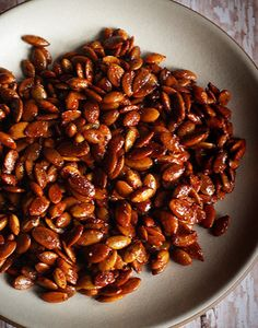 Sweet and spicy and completely irresistible, honey sriracha roasted pumpkin seeds are a tasty snack you can feel good about making at home. Roasted Pumpkin Seeds, Roast Pumpkin, Seasoned Pumpkin Seeds, Spicy Recipes, Fall Recipes, Healthy Recipes, Nut Recipes, Dessert Recipes, Spicy Honey