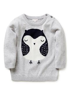 100% Cotton Jumper. Fully fashioned knit, long sleeve jumper. Features owl intarsia on front front. Crew neck, with 3 button opening on left shoulder. Available in Wisp Marle.