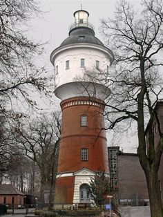 Water tower in Hamburg-Bergedorf, Germany - photo by Uwe Barghaan, via Wikipedia;  The water tower was was completed in 1903, and was used until 1973.  In 1983 it was converted to housing, and was added to the list of monuments in 1986.