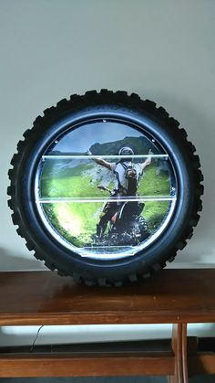 Dirt bike tire shelves with LEDs Dirt Bike Tires, Dirt Bike Room, Motocross Bedroom, Bike Drawing, Car Furniture, Bike Photography, Diy Garage Shelves, Recycled Art, Diy Arts And Crafts
