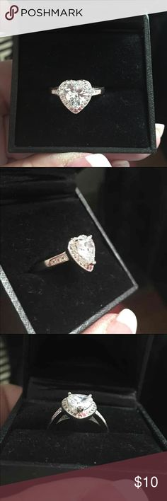 Sterling silver CZ heart ring Sterling silver (not stamped should not turn skin) Size 7.5 New  Feel free to ask questions Check out closet. Everything must go! ⭐️Fast shipping, Mon-Saturday ⭐️Bundle items and Save! ⭐️All items are posted on others, please ask availability prior to buying ⭐Follow me for new items added often ❤️Also on ♏️ercarii for less Jewelry Rings