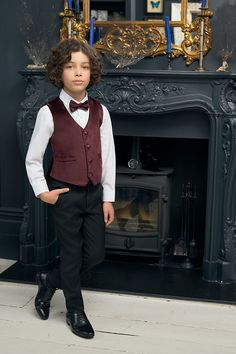 For a luxury look, the Oscar burgundy waistcoat with black striped trousers is a trendy take on a traditional tailoring. Styled with a subtly textured cufflink shirt and coordinating bow tie, the outfit is a first class choice for any special occasion. Trouser Suits, Trousers, Velvet Suit, Boys Suits, Page Boy, Black Stripes, Boy Outfits, Special Occasion, Burgundy