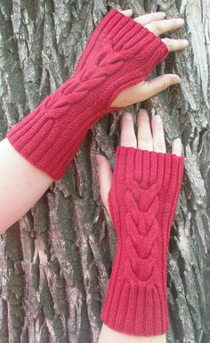 Knitting Pattern for Easy Lucky Horseshoe Hand Warmers - These  fingerless mitts are knit flat on straight needles and seamed. Rated easy by the designer Kim Haesemeyer.