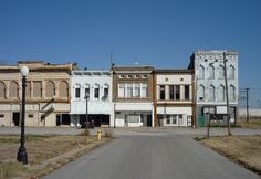 """Cairo, Illinois. Cairo is known for violent race riots and lynching, which tore the town apart and pitted neighbor against neighbor. People still live in this shell of a town. This is their """"downtown"""" not a soul around"""