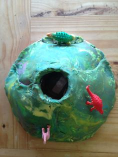 volcano: a jar, a plate tinfoil wrapped around and newspaper under it for some form. Old playdough rolled and laid on top. Little plastic dinosaurs. Vinegar, baking soda and red food colouring