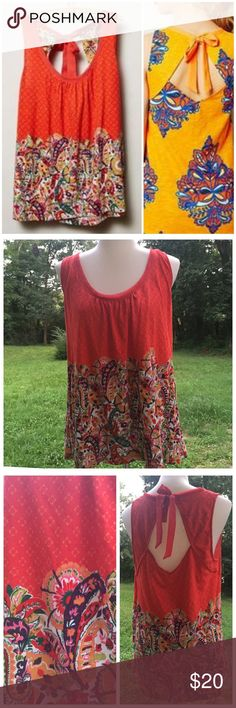 """Anthropologie Akemi + Kin Rosae Cut Out Back Tank Anthropologie Akemi + Kin Rosae Cut Out Back Tank --- size large --- good preloved condition --- no flaws --- 21"""" bust --- 27"""" length ---satiny ribbon tie at back --- bodice hem is trimmed on chiffon like fabric with raw edge --- This listing is for the red/orange shirt only --- Oh so Anthro --- thank you for visiting my boutique, please feel free to ask any questions Anthropologie Tops Tank Tops"""