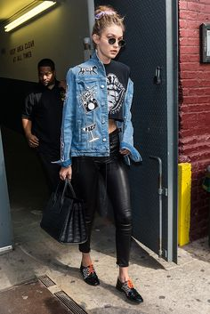 Gigi Hadid leaving the Marc Jacobs SS17 show at New York Fashion Week in patched-up denim and leather