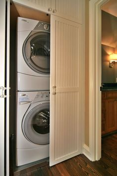 Simple Functional And Amazing Laundry Room Ideas Stacked Washer Dryer With White Interior Door And White Modern Washing Machine Also Woodden Floor And Classic Wall Lamp Lighting Idea - Copy