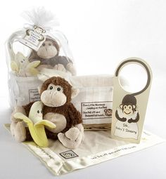 """Along with the precious, plush brown-and-tan toy monkey are a bright-yellow, partially peeled, smiling banana rattle, a baby-sized, soft """"lovie"""" blankie and a door hanger, adorned with a long-tailed monkey hugging a pillow, that lets company know """"baby's sleeping."""" 