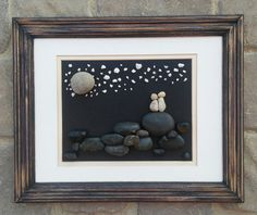 """Pebble Art Couple standing on top of a mountain in an 8x10 """"open"""" wood frame"""