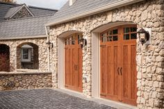 Clopay Canyon Ridge Collection faux wood carriage house style garage doors are a great choice for the harsh climate. Low-maintenance and well insulated, they won't warp. rot, or crack. www.garagedoor4less.com