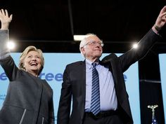 Hillary Clinton, campaigning here Wednesday with Sen. Bernie Sanders, worked to sway millennial voters by promoting a plan to make public c...