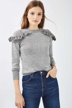 Add a flash of femininity to your casual-cool styles with this long sleeved jumper with ruffle shoulder detailing. Create a contrast look with a pair of ripped jeans. #Topshop