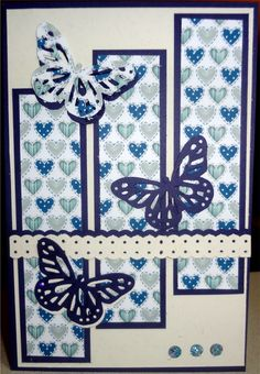 Navy Blue card base.  Cream over top.  Navy Blue and cream hearts mounted on Navy Blue background.  Butterflies punched out of each background color with Martha Stewart punch.  Ribbon make with StampinUP ribbon punch on both contrasting backgrounds.  Three holes punched at bottom corner, backed with tape and filled with glitter.  LOVE IT!