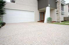 Concreting brisbane for concrete driveways, paths and patio projects. Services include exposed aggregate, stencil concrete and coloured concrete. Exposed Aggregate Driveway, Concrete Driveways, Exposed Concrete, Concrete Patio, Walkways, Driveway Tiles, Driveway Design, Front Walkway Landscaping, Modern Landscaping