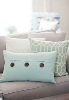 Aqua cushions grey couch - soft classy colours, but do we need more colour?