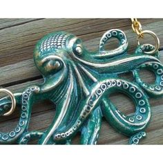 Aqua/ patina octopus....we call him 'Ooky' at bsueboutiques.   You can do this with paint over our silverware finish to achieve a lovely patina look.   Seal with Krylon Acrylic Matte Spray Sealant.