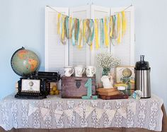 The forgotten often dusty decoration of the globe.  Using maps and globes to decorate your first birthday party or bridal shower is so clever.