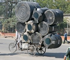 cadenced:  Clive Limpkin photo of an overloaded cyclist in Jaipur, India.