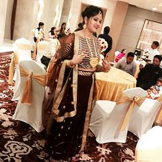 Crop top in brown and golden with a brown lehenga and a heavy dupatta with a beautiful mirror work lace