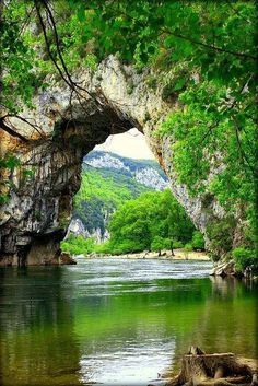 A natural bridge called Pont d'Arc welcomes all along the Ardèche River, giving a grand entrance approaching the Ardèche Canyon. It is located 5 kilometers from the town of Vallon-Pont-d'Arc, Ardèche Department, south of France. Places Around The World, Oh The Places You'll Go, Places To Travel, Places To Visit, Around The Worlds, Wonderful Places, Beautiful Places, Beautiful Pictures, Amazing Photos