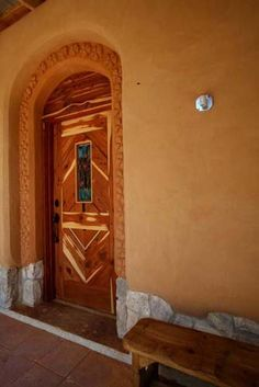 Meek residence. Front door installed. Earthen plaster border by Janet and Ann.