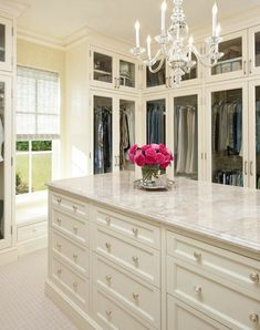 Beautiful crystal chandelier luxury walk in closet design