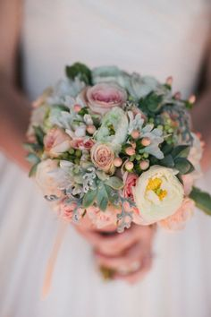 succulents with mixed roses in prink and cream and peach berries. The berries also come in more of a cream color.