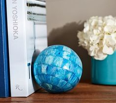 """Blue Bone Sphere Vase Filler - potterybarn Add a natural yet sophisticated touch to a centerpiece bowl with these spheres.   •4"""" diameter  •Made of bone with a polished finish. $16"""
