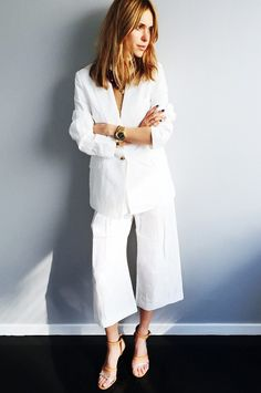 Look de Pernille keeps her look simple in a sleek white jacket + white culottes and delicate jewelry