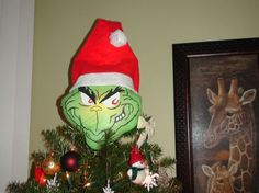 Light up your holiday with a homemade Grinch topper. | 15 Tree Toppers You Didn't Know You Needed This Holiday Season